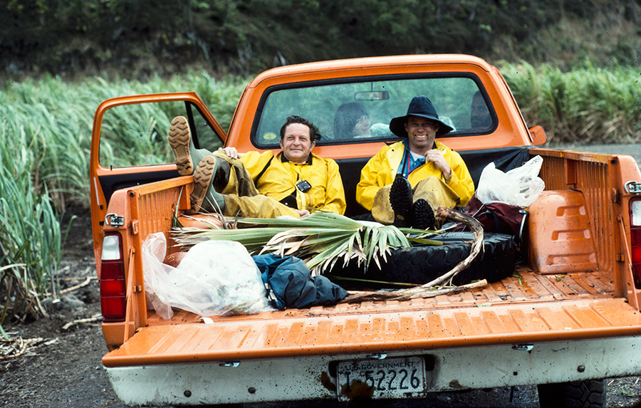 John Sincock, left, and Mike Scott in the back of a pickup truck