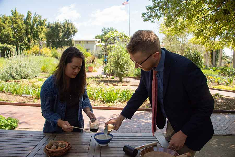 Kelly Fernandez, head gardener of the Herb and Shakespeare gardens, and Joel Klein, Molina Curator for the History of Medicine and Allied Sciences, make iron gall ink, using a recipe from the 1600s. Photo by Deborah Miller.