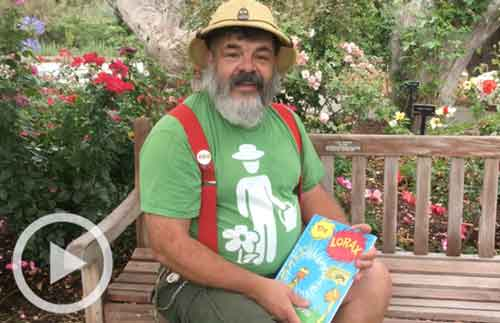 Staff member John with The Lorax book