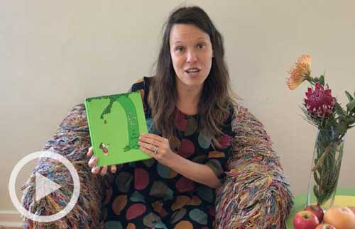 Staff member Kate with The Giving Tree book