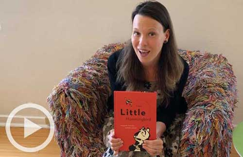 Staff member Kate with The Little Hummingbird book