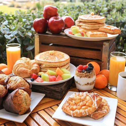 A display of breakfast foods on a buffet