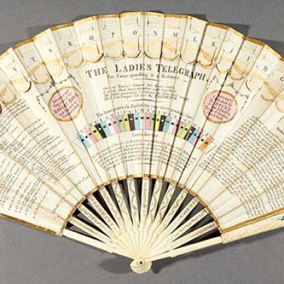 color photograph of paper and wood 1798 hand fan