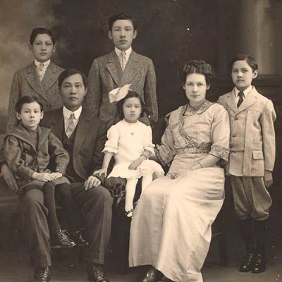 "Portrait of the See Family, including Fong See (second from left) and Letticie ""Ticie"" Pruett (second from right) and their five children, 1914. Unknown photographer. The Huntington Library, Art Museum, and Botanical Gardens."