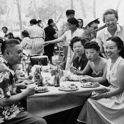 Detail of photograph of Mabel Hong (second from right, standing) at Chinese American Citizens Alliance picnic, 1950s. The Huntington Library, Art Museum, and Botanical Gardens.