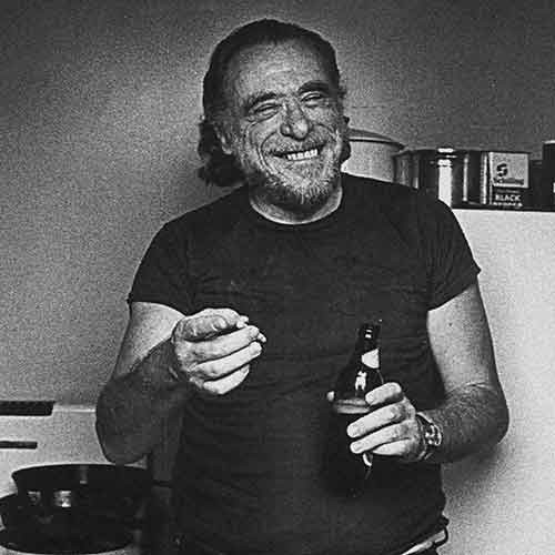 Charles Bukowski holding a cigarette and a beer