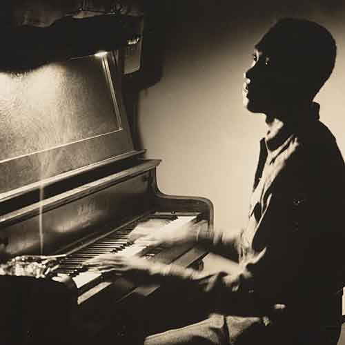 Claudius Wilson on a piano