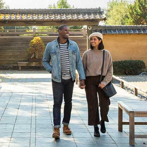 young couple walking in zen garden