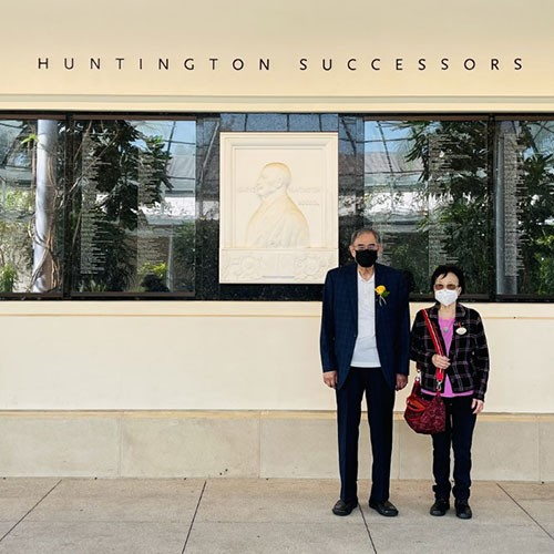 Mr. and Mrs. Chen in front of the Hunting Successors Wall