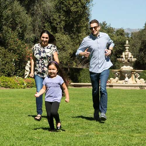 young family running on grass