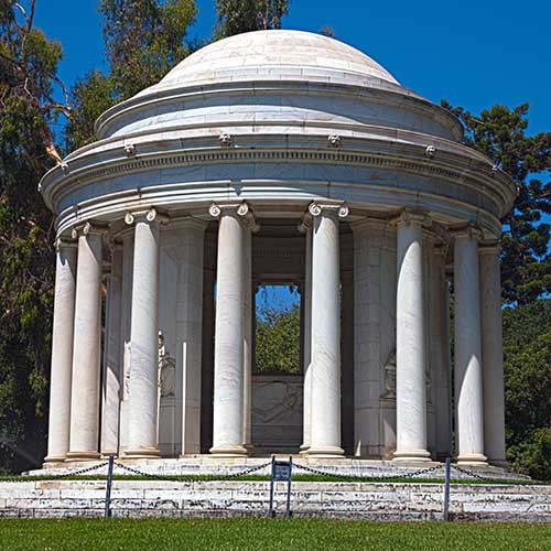 photo of outdoor mausoleum, domed roof with columns circling