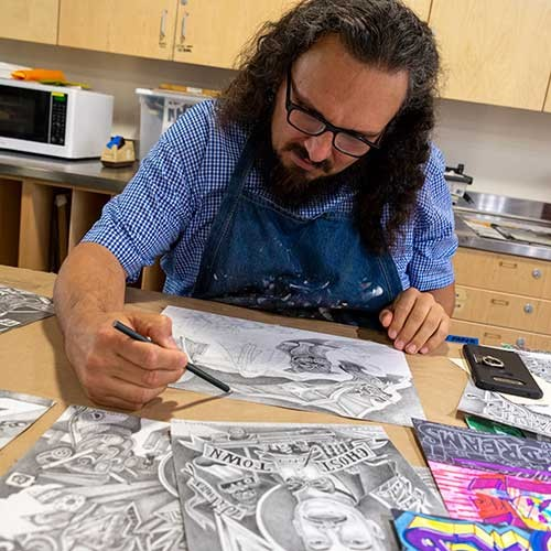 Mario Ybarra Jr works on his illustrations for the huntington