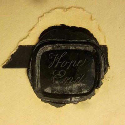 Black wax seal on letter
