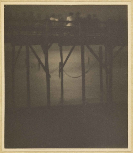 Karl F. Struss, Crowded Pier by Moonlight, Arverne, Long Island, New York, 1910–1912, sepia toned platinum print, 4 1/4 × 3 5/8 in. The J. Paul Getty Museum, Los Angeles. © 1983 Amon Carter Museum of Art, Fort Worth, Texas.