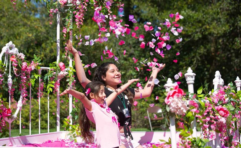 two girls throwing petals for Earth Day celebration