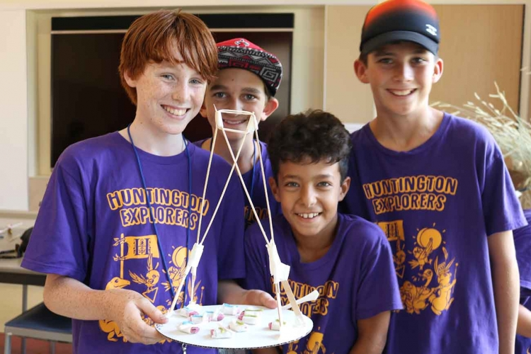Group of explorers campers showing their project