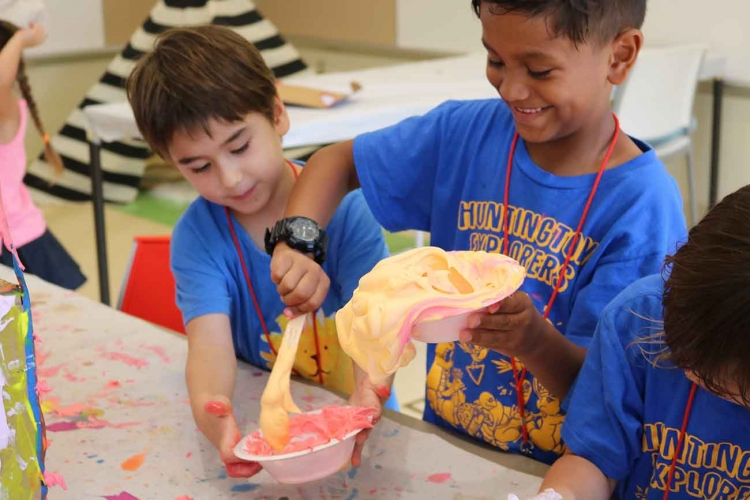 Campers pouring paint into bowl