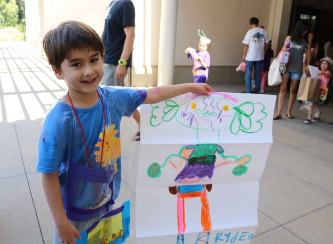 Boy showing his drawing project