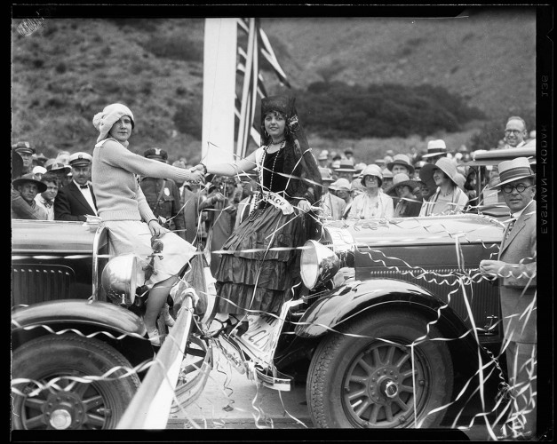 Powell Press Service, Women representing Canada and Mexico shaking hands at the Roosevelt Highway Dedication, Sycamore Canyon, Malibu, June 29, 1929. Ernest Marquez Collection. photCL 555 06 1348