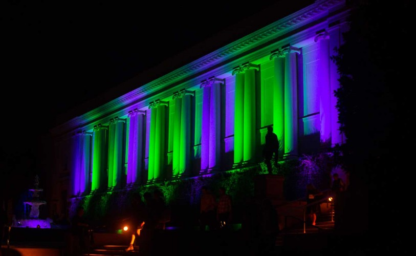 The Huntington Library illuminated by purple and green lights