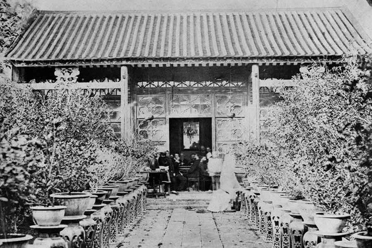 Old photograph of a gathering in a Chinese garden