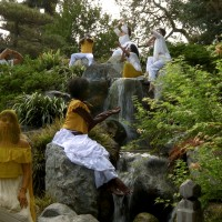 Video still depicting dancers in the Japanese Garden at The Huntington for Apariciones/Apparitions, a video work by Carolina Caycedo. Choreography by Marina Magalhães; cinematography by David de Rozas. Jointly owned by The Huntington Library, Art Collections, and Botanical Gardens and the Vincent Price Art Museum Foundation. Image courtesy of the artist.