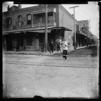 Unknown photographer, Chinese woman walking at the intersection of Alameda Street and Marchessault Street in Old Chinatown, Los Angeles, ca. 1900. The Huntington Library, Art Museum, and Botanical Gardens.