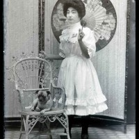 Unknown photographer, Woman posing for a studio portrait while holding a parasol, Old Chinatown, Los Angeles, ca. 1900. The Huntington Library, Art Museum, and Botanical Gardens.