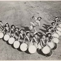 Mei Wah Drum Corps led by Drum Majorette Barbara Jean Wong Lee, 1940. The Huntington Library, Art Museum, and Botanical Gardens.