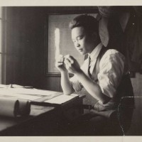 Peter SooHoo Sr. working at a drafting table, 1920s. The Huntington Library, Art Museum, and Botanical Gardens.