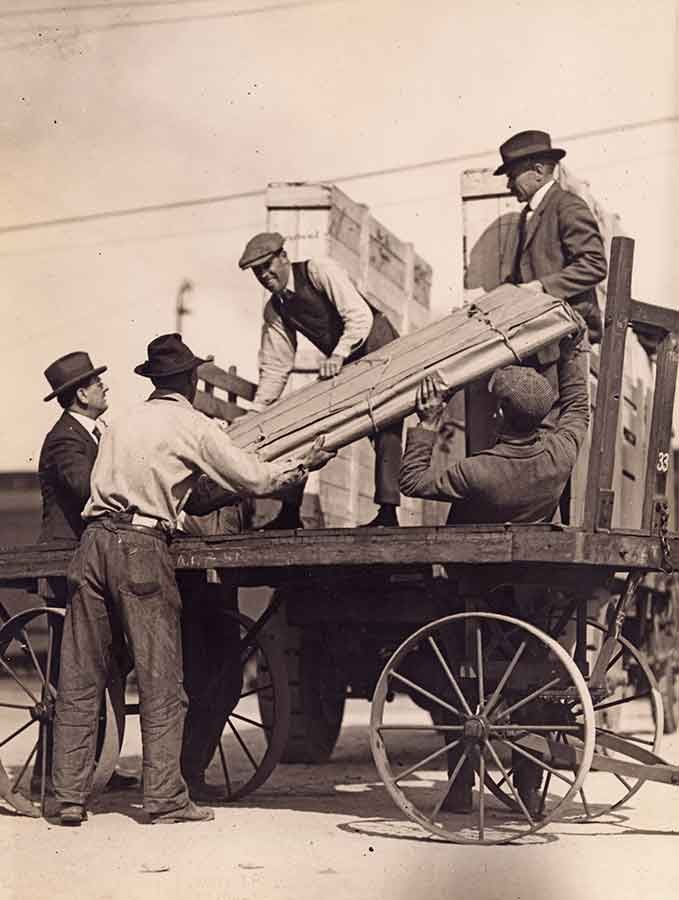 """Photo by """"International,"""" Los Angeles Bureau. """"Famous Painting Arrives."""" The Blue Boy being unloaded from a train, 1922. The Huntington Library, Art Museum, and Botanical Gardens."""