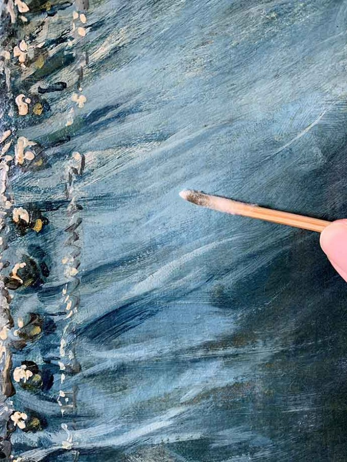 The conservator removed dirt trapped underneath the varnish (as seen on the cotton swab), which clouded the clarity of Gainsborough's masterful brushwork. The Huntington Library, Art Museum, and Botanical Gardens.