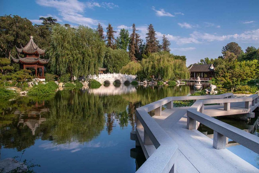 View of the Lake of Reflected Fragrance, showing some of the original features that opened in 2008 (l–r): the Pavilion of the Three Friends, the Jade Ribbon Bridge, and the Hall of the Jade Camellia. In the foreground is the Bridge of the Joy of Fish. Photo by Martha Benedict. The Huntington Library, Art Museum, and Botanical Gardens.