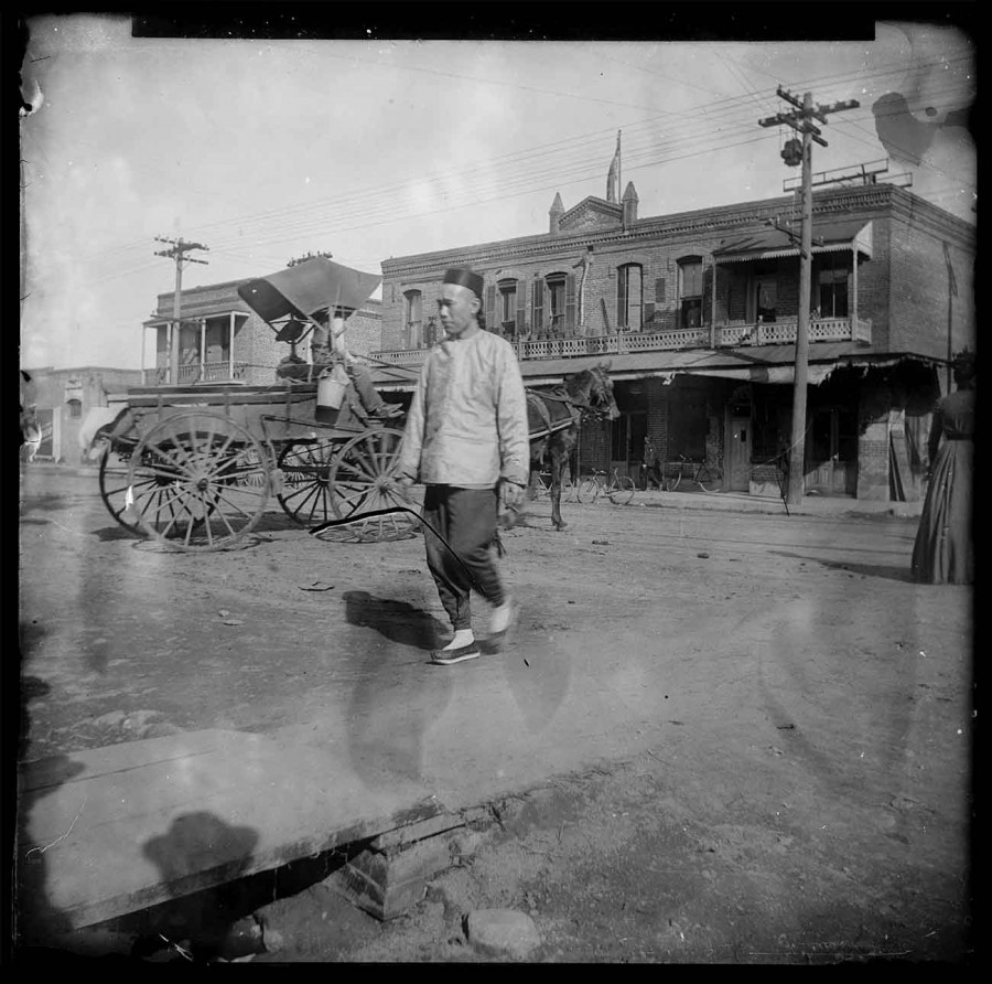 Unknown photographer, Chinese man walking near the intersection of Alameda Street and Marchessault Street in Old Chinatown, Los Angeles, ca. 1900. The Huntington Library, Art Museum, and Botanical Gardens.