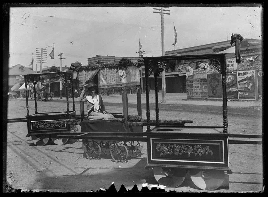Unknown photographer, Western woman posing for a photograph on a ceremonial handcart, Old Chinatown, Los Angeles, 1902. The Huntington Library, Art Museum, and Botanical Gardens.