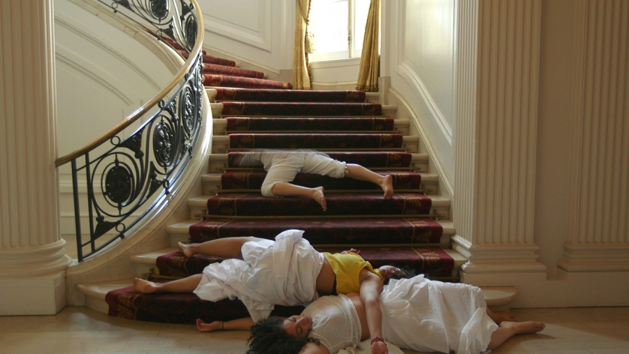 Performers sprawled on staircase