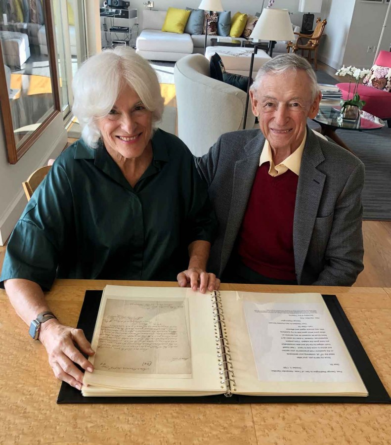 Susan R. and L. Dennis Shapiro with some of their presidential letters and related materials.