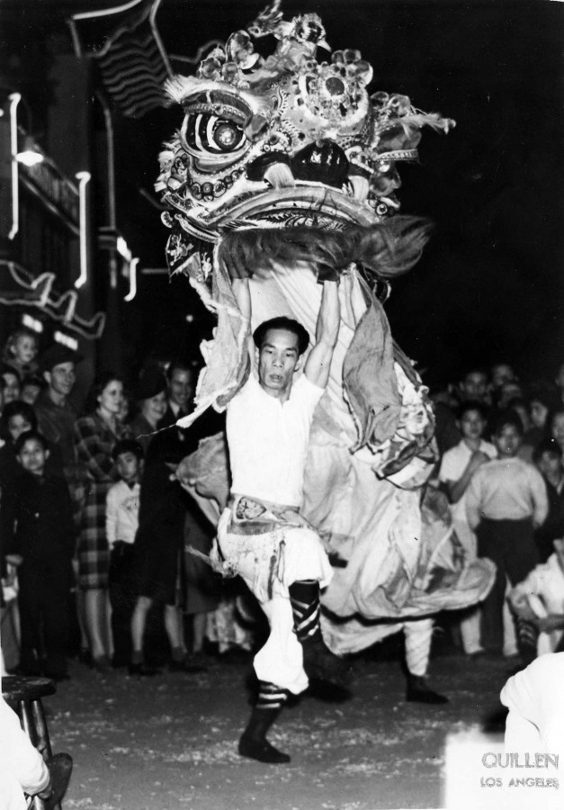 Lion dance for Chinese New Year in New Chinatown Central Plaza, 1940s. Los Angeles Public Library, Harry Quillen Photo Collection.