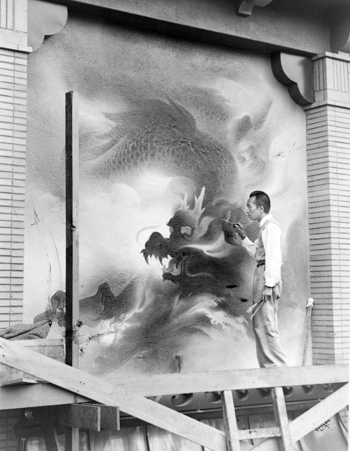 Artist Tyrus Wong paints a dragon mural on building exterior in Chinatown Central Plaza, 1941. Los Angeles Public Library, Harry Quillen Photo Collection.