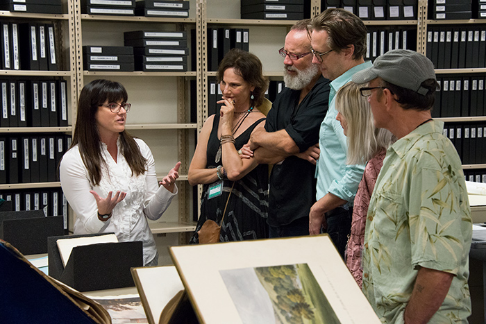 Vanessa Wilkie, William A. Moffett Curator of British Historical Manuscripts, shows visitors from A Noise Within Theatre Company selections from The Huntington's collections relating to the production of Tom Stoppard's play Arcadia. Left to right: Vanessa Wilkie, Susan Angelo, Geoff Elliott, Eric Curtis Johnson, Alicia Green, and Stephen Weingartner. The Huntington Library, Art Collections, and Botanical Gardens. Photo by Kate Lain.