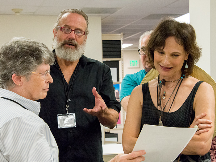 "Sara S. ""Sue"" Hodson, curator of literary manuscripts, shows off an early typed draft of Tom Stoppard's play Arcadia. Left to right: Sara S. ""Sue"" Hodson, Geoff Elliott, Mitchell Edmonds, and Susan Angelo. The Huntington Library, Art Collections, and Botanical Gardens. Photo by Kate Lain."