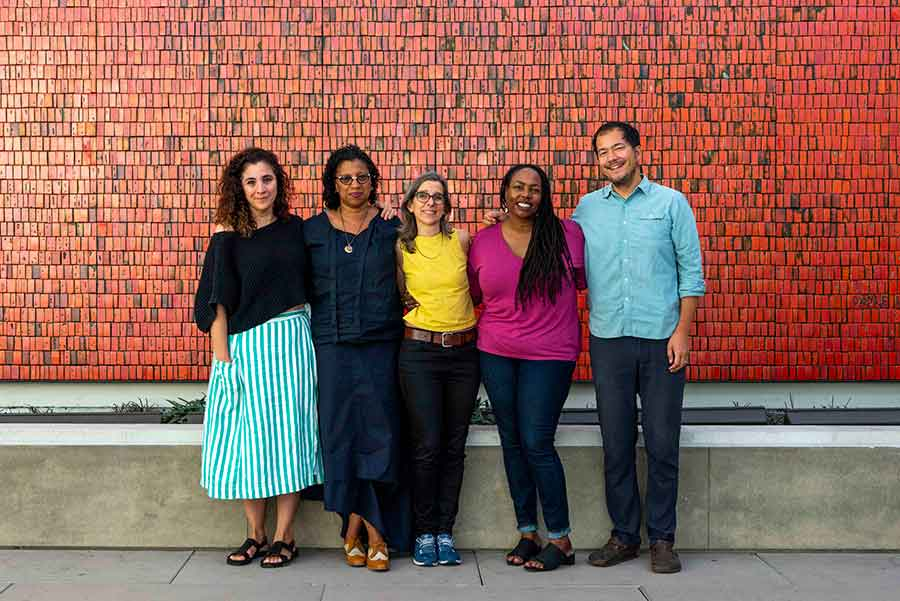 "The exhibition ""Beside the Edge of the World"" features work by the following artists and writers (left to right): Beatriz Santiago Muñoz, Robin Coste Lewis, Nina Katchadourian, Dana Johnson, and Rosten Woo. They stand before Doyle Lane's Mutual Savings and Loan Mural, 1964, at The Huntington. Photo by Kate Lain. The Huntington Library, Art Museum, and Botanical Gardens."