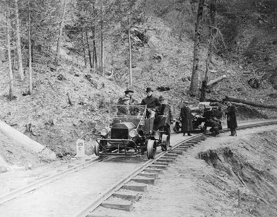 Henry E. Huntington (seated on the right in the backseat of the closer automobile), inspecting track at Big Creek, California, on April 7, 1914. In 1910, Huntington purchased the water rights to Big Creek, a branch of the south fork of the San Joaquin River in eastern Fresno County, and set about designing the first massively scaled hydroelectric project in the United States. Unknown photographer. The Huntington Library, Art Museum, and Botanical Gardens.