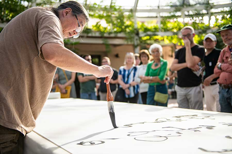"On Nov. 4, 2018, contemporary artist Tang Qingnian gave a calligraphy demonstration at The Huntington, sharing a Tang-dynasty era poem, ""Song of Eight Drinking Immortals,"" that celebrates eight scholars who were known for their love of liquor. Photo by Jamie Pham."