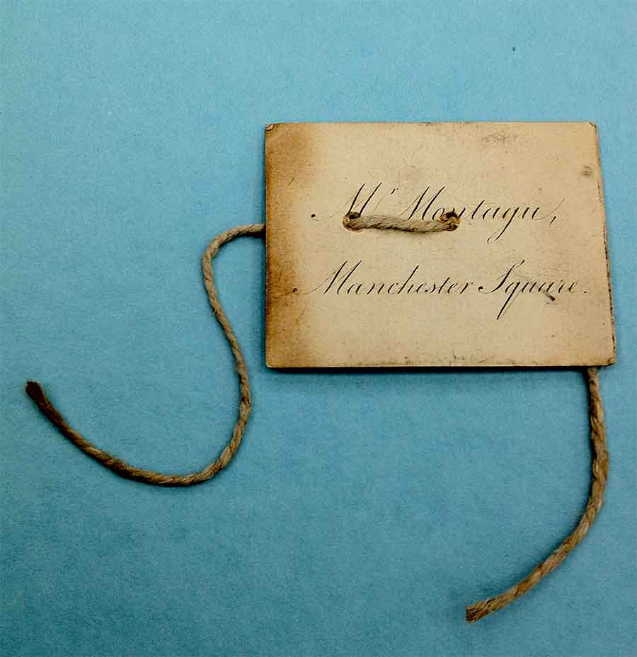 Filing tag made from printed visiting card of Mr Montagu Manchester Square