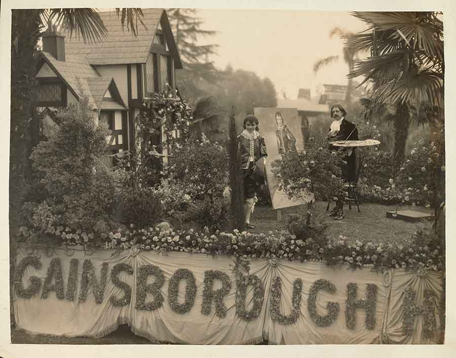 "In 1928, a commercial float designed by J. T. Edwards advertised the new ""Gainsborough Heath"" residential subdivision in San Marino. The float, and the subdivision, were inspired by The Huntington's British art collections. Edwards rode the float dressed as Thomas Gainsborough, and his daughter Honey portrayed The Blue Boy. J. T. Edwards Photograph Collection. The Huntington Library, Art Museum, and Botanical Gardens."
