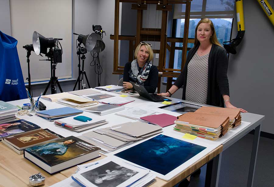 "Melinda McCurdy in 2018 with Christina O'Connell, Mary Ann and John Sturgeon Senior Paintings Conservator, preparing for the exhibition ""Project Blue Boy."" Photo by Deborah Miller."