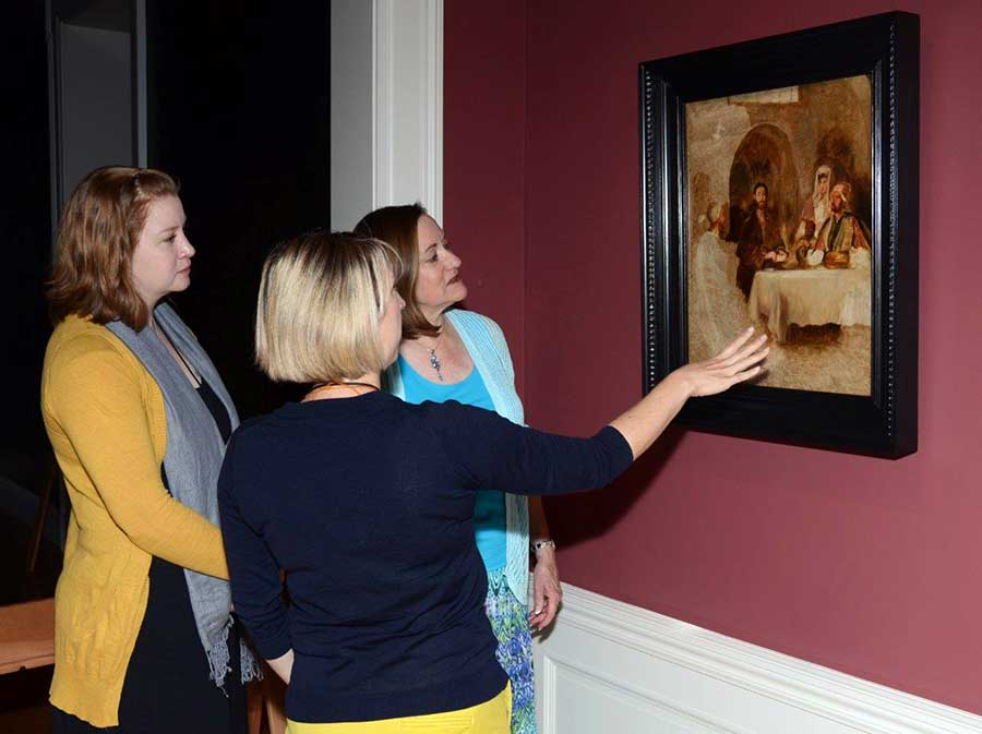Melinda McCurdy (center) in 2015 with donor Tooey Durning (right) and Christina O'Connell (left), viewing David Wilkie's Supper at Emmaus at the Huntington Art Gallery. Photo by Lisa Blackburn.