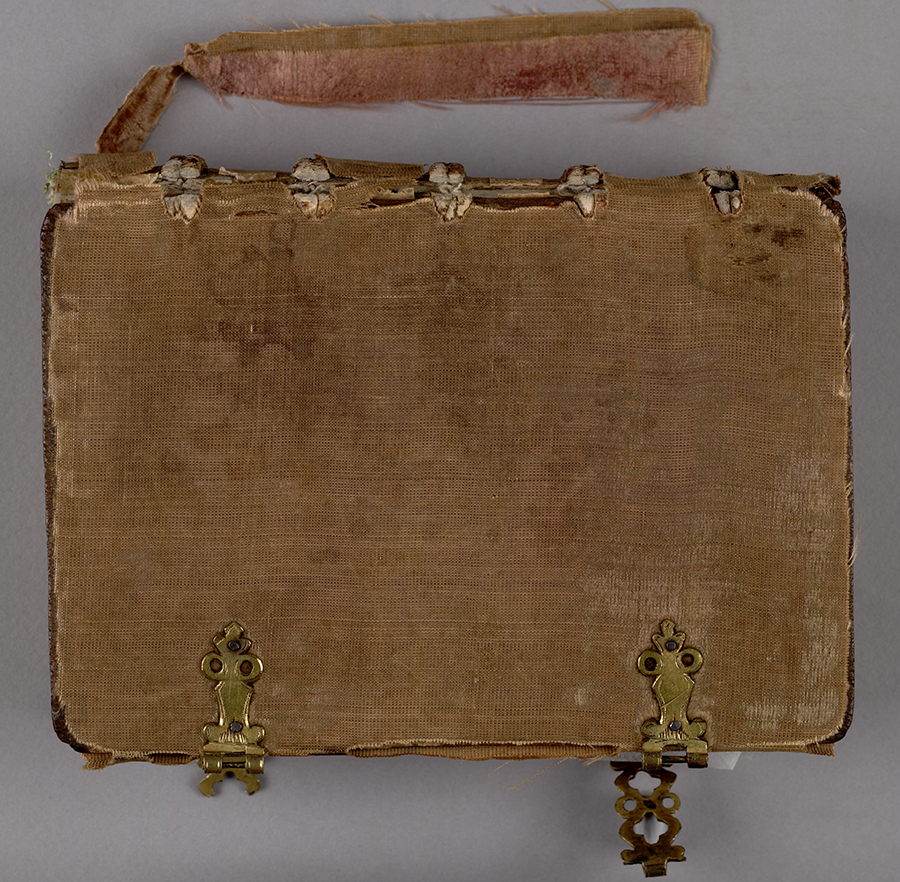 Binding inside front cover, showing pegging of the thongs and offset of the former pastedown. Huntington Manuscript 1200. The Huntington Library, Art Collections, and Botanical Gardens.