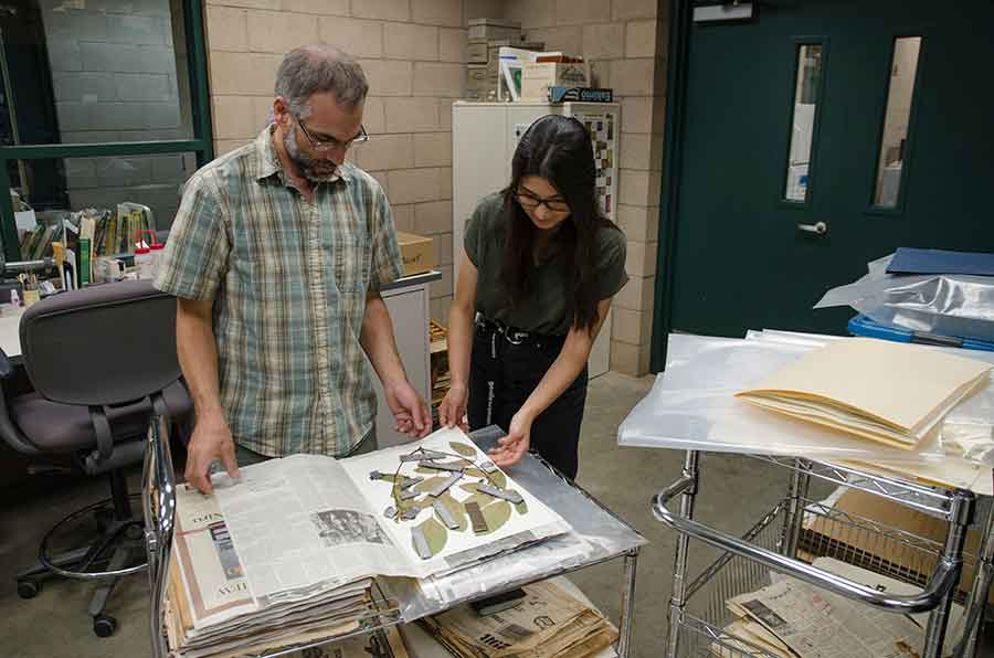 Brian Dorsey, The Huntington's chief botanical researcher, and botanical intern Dana Austria examine plant materials that are being dried and collected for the Global Genome Initiative. Photo by Lisa Blackburn.